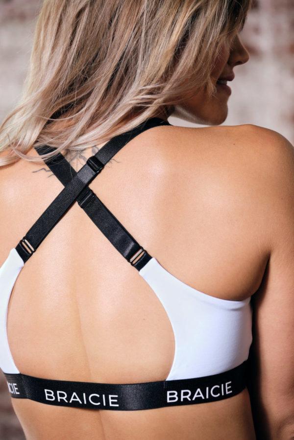 Rückenansicht Detail einer Frau im BRAICIE Empower Sport-BH in weiß